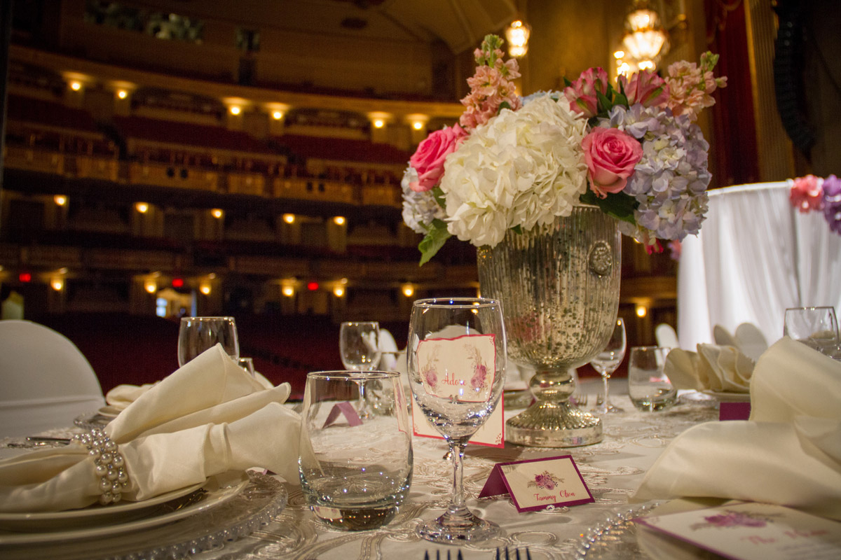 Flower centerpiece on table on stage