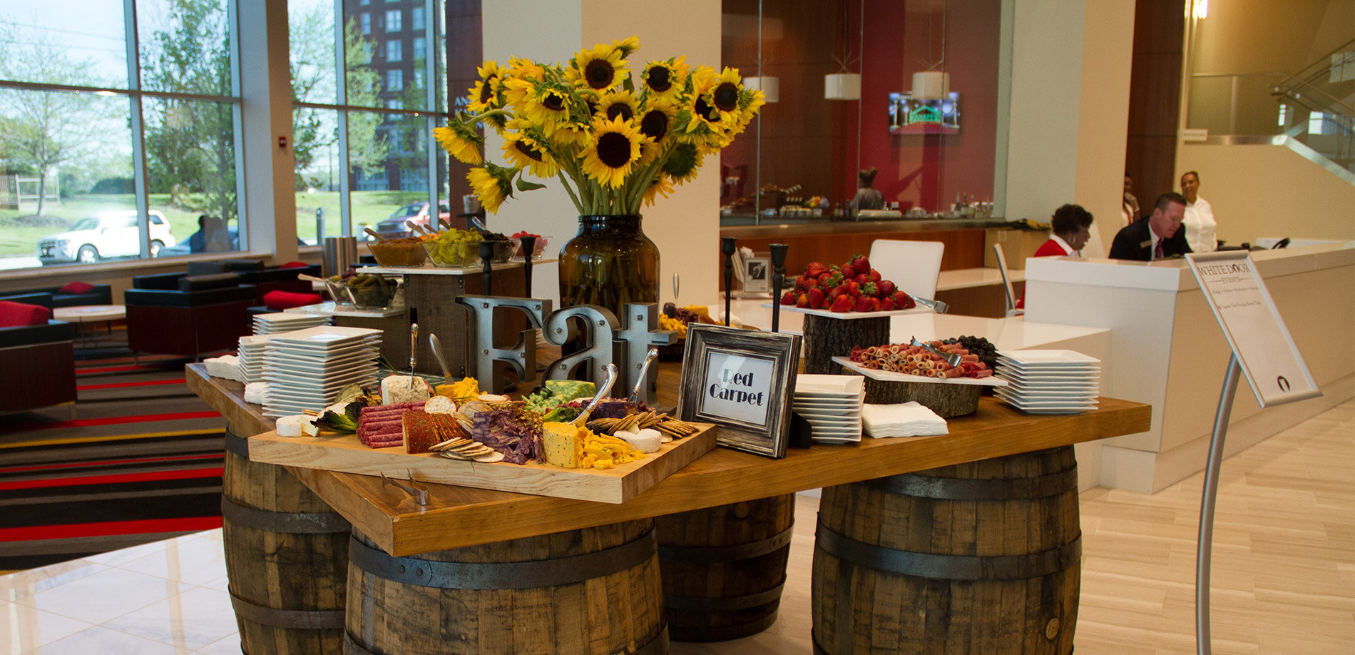 Buffet table on barrels with sunflowers