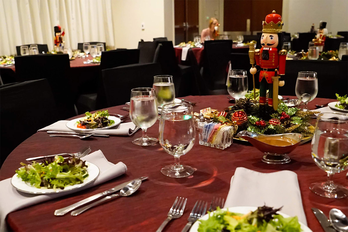 Salads placed on red tablecloths in Reception Hall