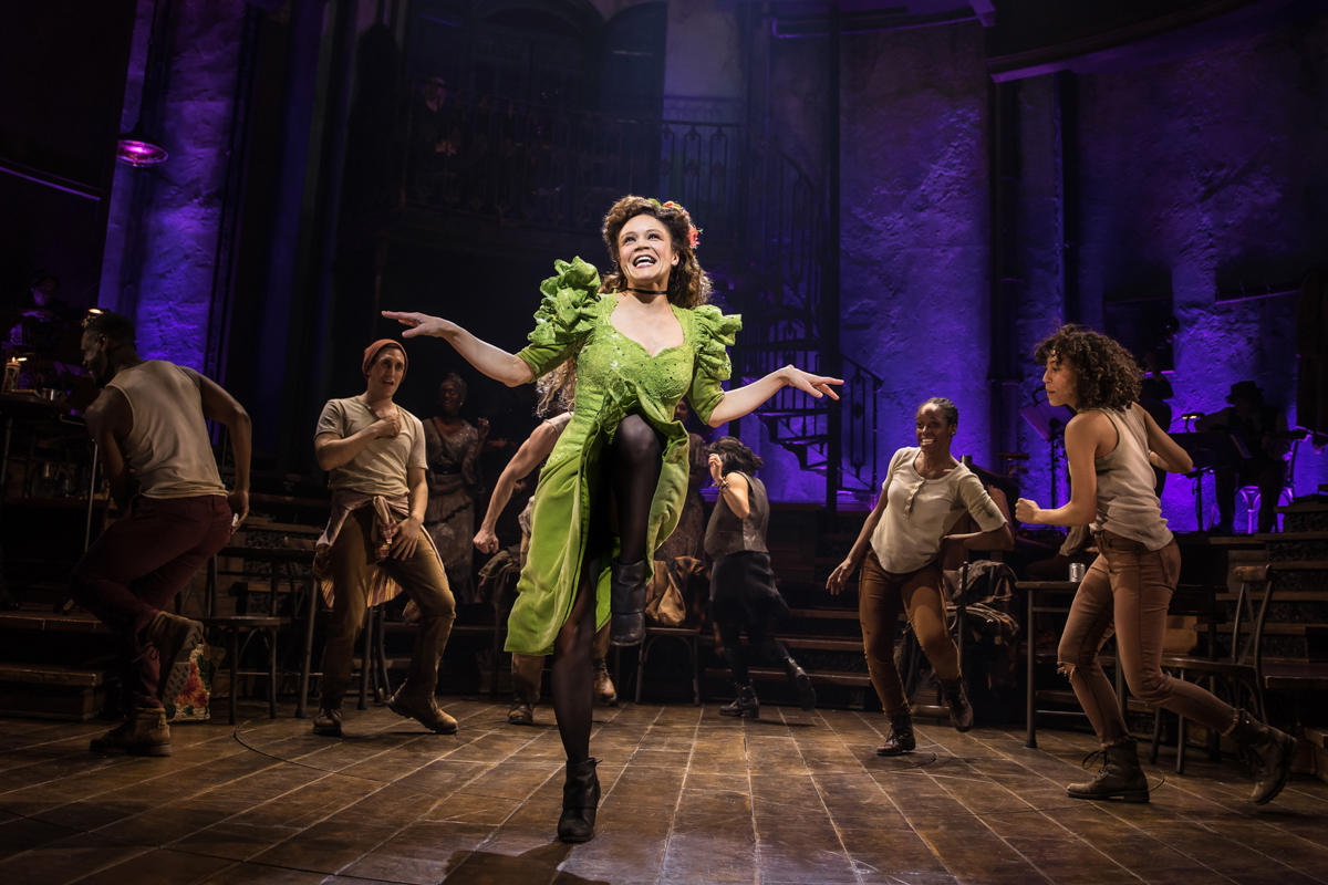 Hadestown, Persephone in green dancing.